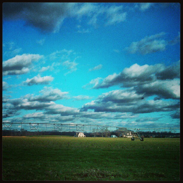 Big sky and a farm house